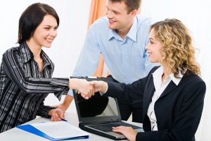 Photo of business women shaking hands at meeting